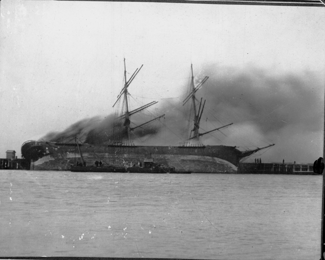 Hilaria on fire at Town Pier Port Melbourne. 1895 (Brodie Collection, La Trobe Picture Collection, State Library of Victoria)