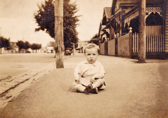 John Beaumont, sitting on the footpath in Bridge Street, Port Melbourne circa 1943.