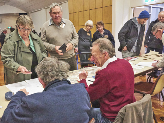 Virginia Snell renews her membership with Jim Power (left) and Glen Cosham (right) while Jim Holdsworth waits his turn.